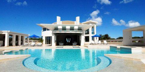 Swimming pool, Property, Fluid, Real estate, Aqua, Azure, Resort, Turquoise, Villa, Water feature,