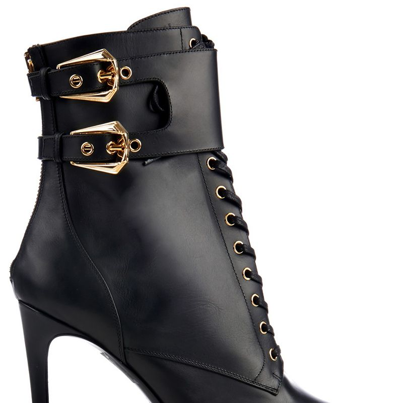 "<p><strong>Balmain</strong> boots, $1,245, <a href=""http://www.matchesfashion.com/us/products/Balmain-Nina-double-buckle-leather-ankle-boots-1026308#"" target=""_blank"">matchesfashion.com</a>.</p>"