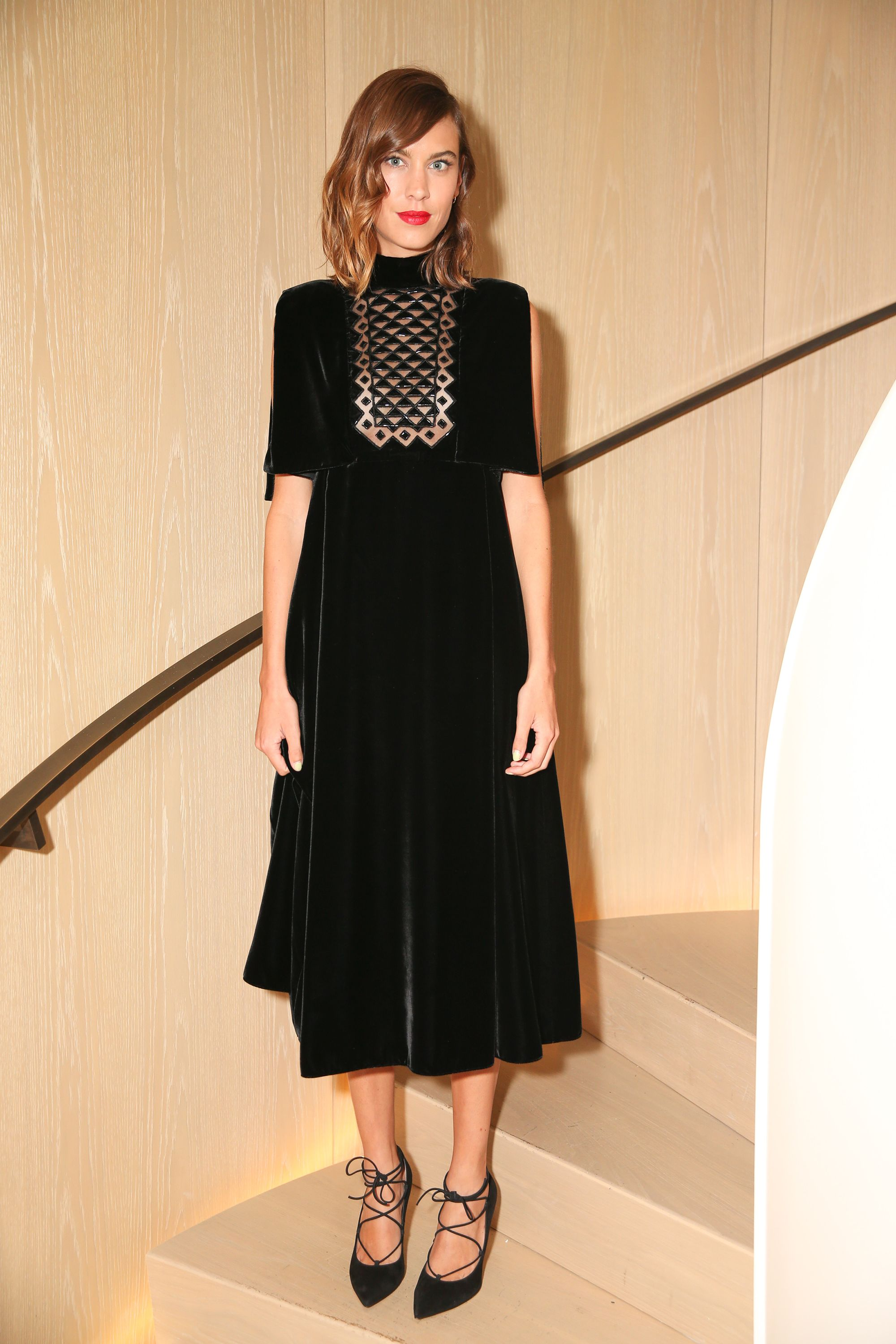 <p>Cut in the finest velvet with laser-cut bib pattern, Alexa Chung's Erdem LBD is anything but basic. </p>