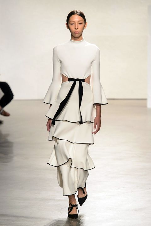 <p>Jack McCollough and Lazaro Hernandez take a visual trip to Spain and offer a gown in black and white with ruffles and cut-outs—tied up in a perfect bow. </p>