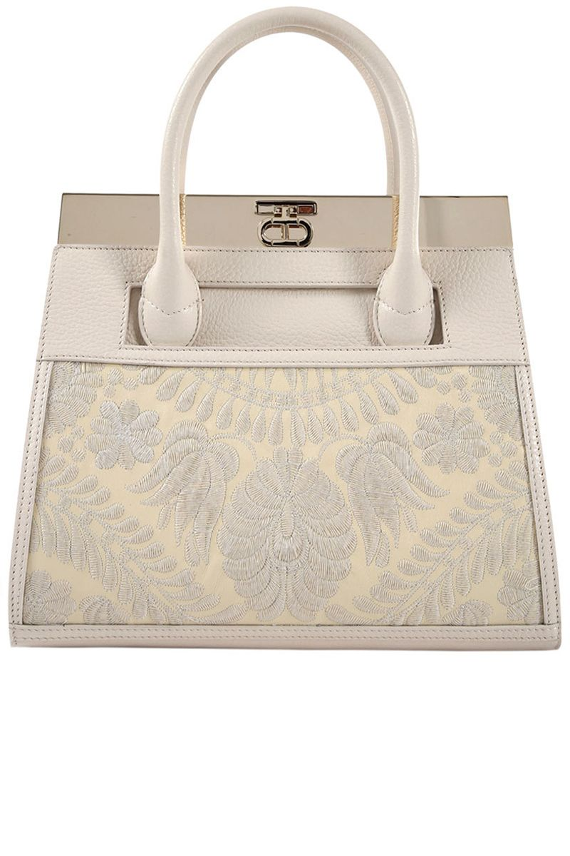 """<p>""""For work, I use one of my tote bags because I'm always carrying too many things.""""<br></p><p><strong>Dee Ocleppo </strong>beige tote, $2,195, <strong><a href=""""https://shop.harpersbazaar.com/designers/d/dee-ocleppo/beige-roma-tote-6001.html"""" target=""""_blank"""">shopBAZAAR.com</a></strong>. </p>"""