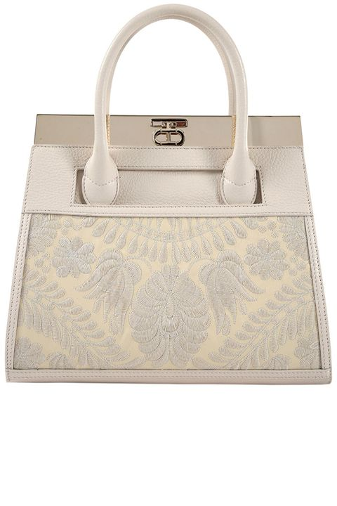 "<p>""For work, I use one of my tote bags because I'm always carrying too many things.""<br></p><p><strong>Dee Ocleppo </strong>beige tote, $2,195, <strong><a href=""https://shop.harpersbazaar.com/designers/d/dee-ocleppo/beige-roma-tote-6001.html"" target=""_blank"">shopBAZAAR.com</a></strong>. </p>"