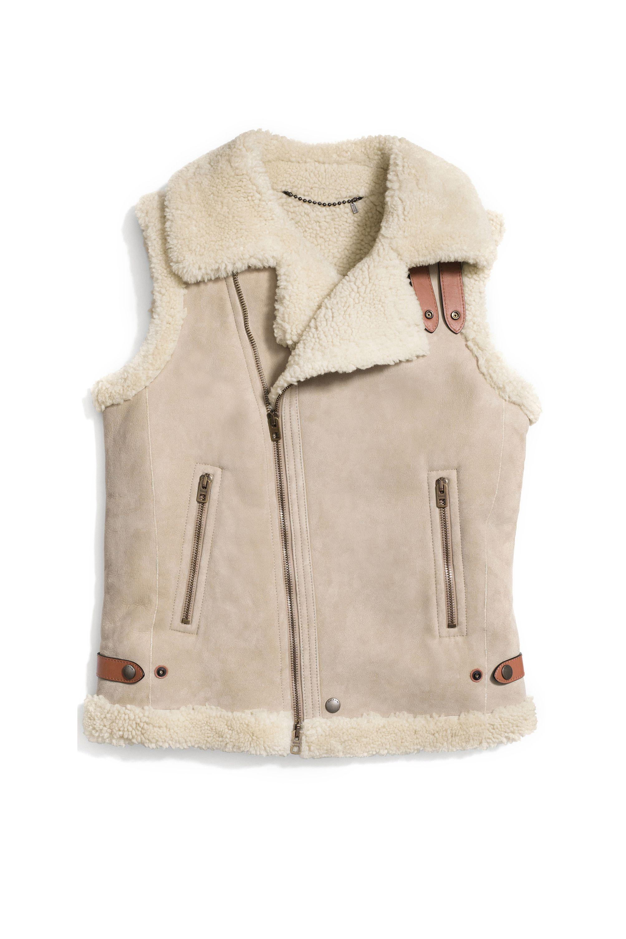 "<p><strong>Coach</strong> vest, $995, <a href=""http://www.coach.com/coach-designer-coats-sheepskin-moto-vest/85932.html?cid=D_B_HBZ_9849"" target=""_blank"">coach.com</a>.</p>"