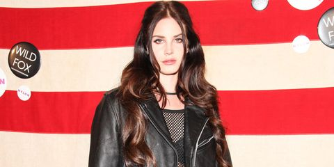 Lip, Hairstyle, Jacket, Textile, Red, Style, Leather jacket, Leather, Step cutting, Long hair,