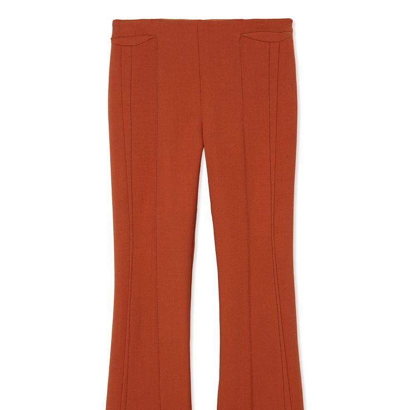 """<p><strong>Derek Lam </strong>trousers,$990, <strong><a href=""""https://shop.harpersbazaar.com/designers/derek-lam/flare-leg-trouser/"""" target=""""_blank"""">shopBAZAAR.com</a></strong>.</p>"""