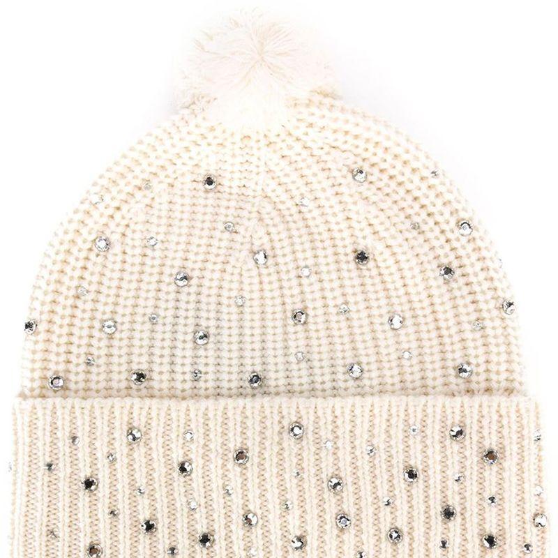 "<p><strong>Markus Lupfer</strong> beanie, $225, <strong><a href=""https://shop.harpersbazaar.com/designers/m/markus-lupfer/ivory-wool-jewel-beanie-6040.html"" target=""_blank"">shopBAZAAR.com</a></strong>.</p>"