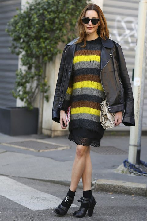 <p>You already know this woman loves bold details and mix-and-match patterns. Here, a delicate slip adds an ethereal touch to a thick striped sweater, making it the ideal airy-cozy combo.</p>