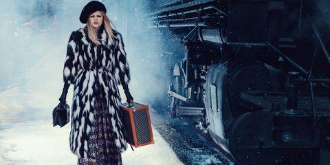 Textile, Winter, Street fashion, Bag, Fur, Luggage and bags, Fashion model, Vintage clothing, Overcoat, Fashion design,