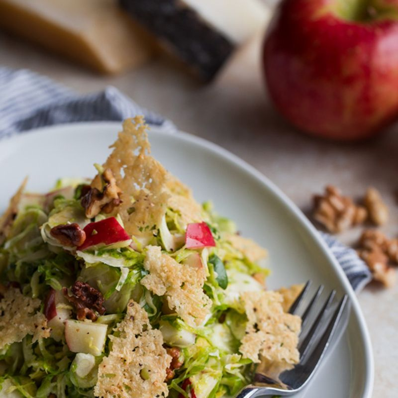 """<p><a href=""""http://www.bloggingoverthyme.com/brussels-sprouts-salad-apple-walnuts-parmesan-pecorino-crisps/print/"""" target=""""_blank"""">Brussels Sprouts Salad with Apple, Walnuts, and Parmesan-Pecorino Crisps<br><br></a></p><p><em>From: Laura Davidson of <a href=""""http://www.bloggingoverthyme.com/"""" target=""""_blank"""">Blogging Over Thyme</a></em></p><p><strong>Ingredients<br><br></strong></p><p><u>Lemon Walnut Vinaigrette:</u>1/3 cup lemon juice</p><ul><li>1.5 teaspoons Dijon mustard</li><li>1/2 teaspoon honey</li><li>1/3 cup walnut oil (or extra virgin olive oil)</li><li>Kosher salt</li><li>Freshly ground black pepper</li></ul><p><u>Parmesan-Pecorino Crisps:<br><br></u></p><ul><li>1 ounce parmigiano-reggiano cheese, finely box-grated</li><li>1 ounce pecorino cheese, finely box-grated</li><li>Cracked black pepper</li></ul><p><u>Brussels Sprout Salad:</u></p><ul><li>1 and 3/4 lb Brussels sprouts</li><li>1 large Honeycrisp apple, cored and cut into 1/2-inch chunks (heaping cup or so)</li><li>3/4 cup toasted walnuts, roughly chopped</li></ul><p><strong>Directions:</strong></p><p>Preheat the oven to 400 degrees Fahrenheit. Line a large baking sheet with a silicone baking mat (eg. Silpat) or flat sheet of parchment paper.</p><p>While the oven preheats, prepare the vinaigrette. In a medium bowl, whisk together the lemon juice, Dijon mustard, and honey until well combined. Slowly pour in the walnut oil, whisking continuously with your other hand, until the vinaigrette is well emulsified. Season to taste with salt and pepper. Set aside.</p><p>Combine the grated cheese in a small bowl. Place six  (roughly equal in size) large spoonfuls of cheese on the baking sheet, leaving an inch in between. Pat the cheese down into large circles until the cheese forms a thin layer.</p><p>Sprinkle the cheese with cracked black pepper. Bake the cheese at 400 degrees for 5-7 minutes, or until golden brown and crisp. Allow the crisps to cool slightly before transferring to a wax or parchment-lined plat"""