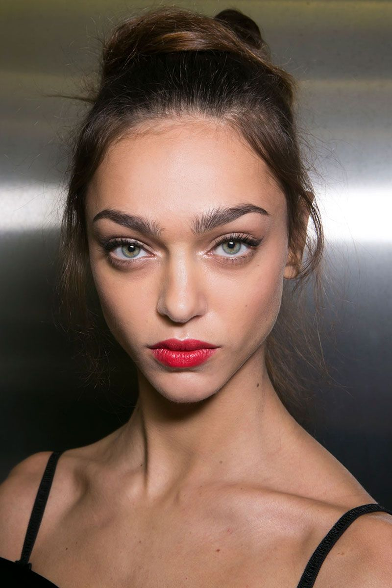 <p>Red lipstick is classic, of course, but never have makeup artists been so united on the shade front as they were this season. The color to know: Snow White apple red—as true as it gets. The finish—satin, like at Dolce & Gabbana (left); patent lacquer, at Nina Ricci; or stay-in-place-all-night matte, at DKNY— is fair game, so long as the lipstick is applied with utter precision.  </p>