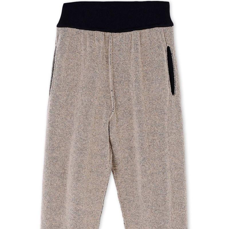"<p><strong>Adidas x Kanye West </strong>pants, $1,170, <strong><a href=""https://shop.harpersbazaar.com/designers/a/adidas-x-kanye-west/boucle-knit-pants-6669.html"" target=""_blank"">shopBAZAAR.com</a></strong>. </p>"