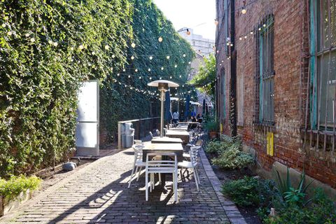 Plant, Neighbourhood, Outdoor table, Shrub, Hedge, Cobblestone, Garden, Walkway, Brick, Yard,