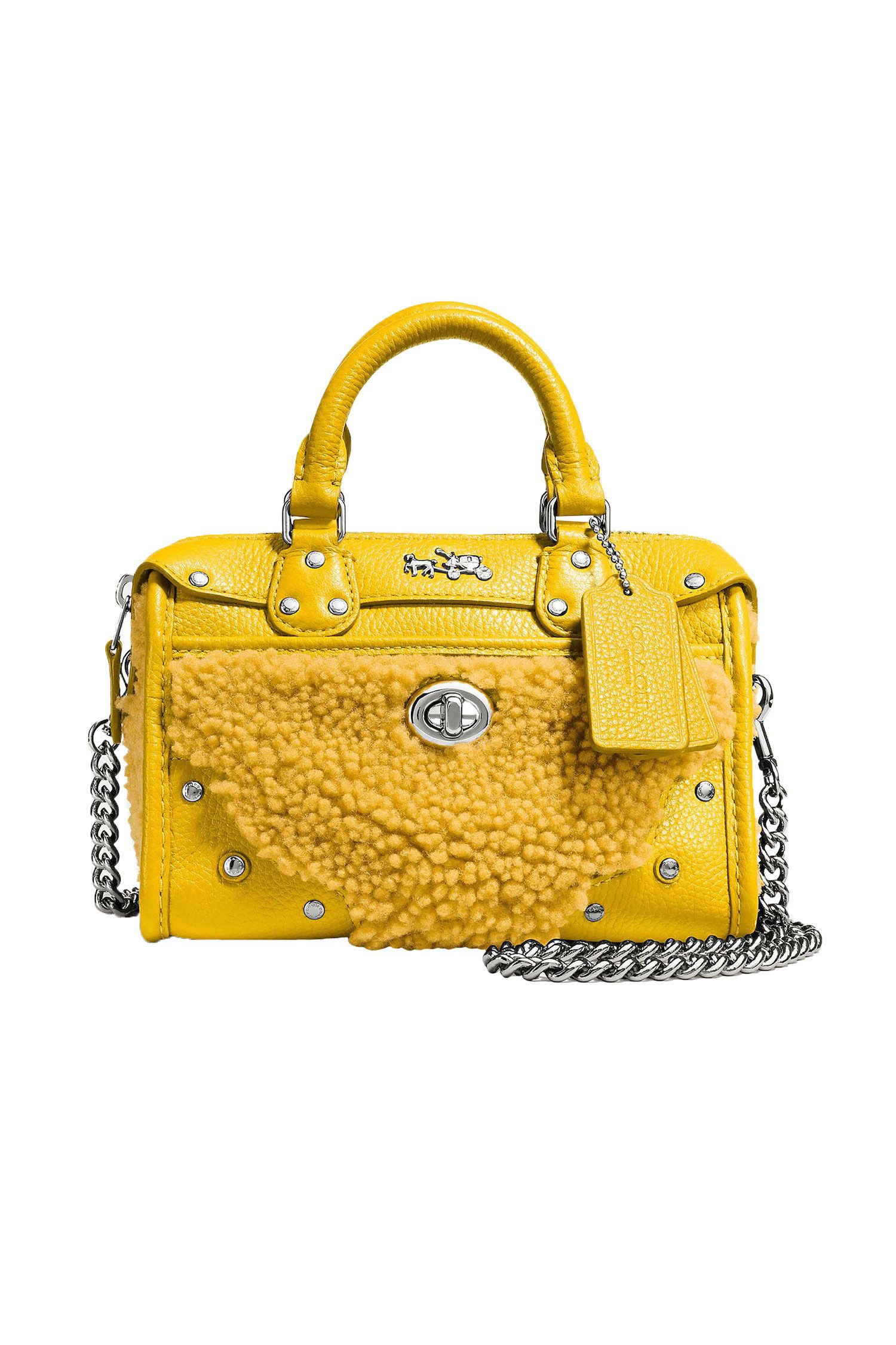 "<p><em>Coach Rhyder Satchel 19, $295, <a href=""http://www.coach.com/coach-designer-handbags-rhyder-satchel-18-in-shearling/36478.html?dwvar_color=SVBAN&cid=D_B_HBZ_9913"" target=""_blank"">coach.com</a>.</em></p>"