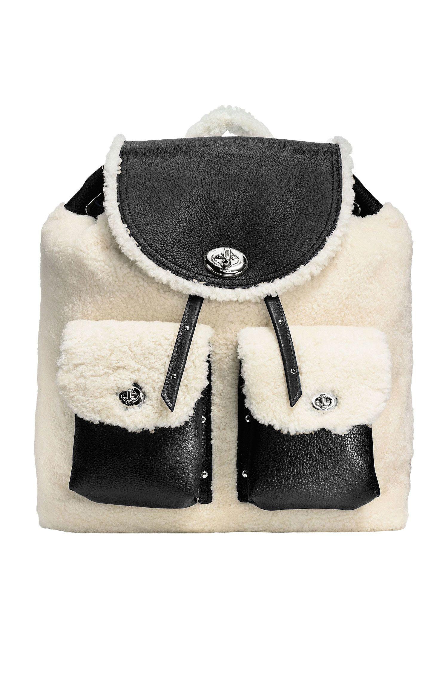 """<p><em>Coach Turnlock Tie Rucksack, $550, <a href=""""http://www.coach.com/coach-designer-backpacks-turnlock-tie-rucksack-in-shearling/36484.html?cid=D_B_HBZ_9910"""" target=""""_blank"""">coach.com</a>.</em></p>"""