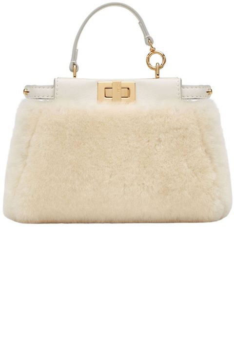 "<p><strong>Fendi </strong>bag, $1950, <a href=""https://shop.harpersbazaar.com/designer/fendi/micro-shearling-peekaboo.html"" target=""_blank""><strong>shopBAZAAR.com</strong></a>.</p>"