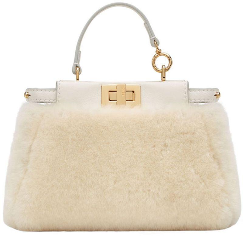 "<p><strong>Fendi </strong>bag, $1950, <a href=""https://shop.harpersbazaar.com/designer/fendi/micro-shearling-peekaboo.html"" target=""_blank""><strong>shopBAZAAR.com</strong></a>.</p>"