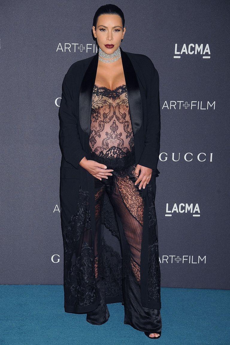 Kim Kardashian Shows Off Baby Bump In Sheer Dress At