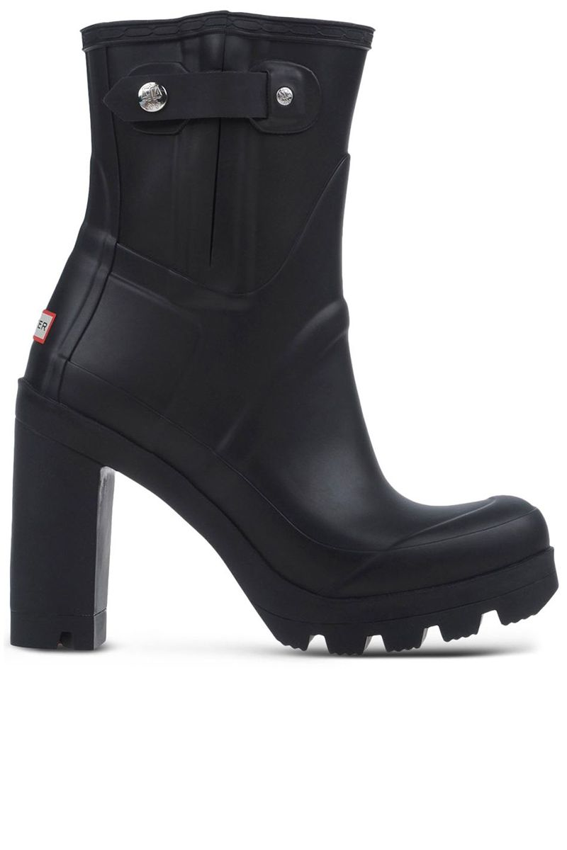 "<p><strong>Hunter </strong>boot, $215, <strong><a href=""https://shop.harpersbazaar.com/designers/h/hunter/black-rubber-rain-boots-6673.html"" target=""_blank"">shopBAZAAR.com</a></strong>.</p>"