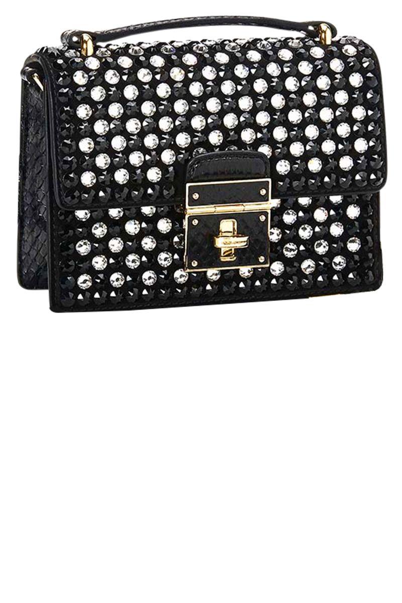 <p><strong>Dolce & Gabbana</strong> bag, $2,695, 877-70-DGUSA. </p>