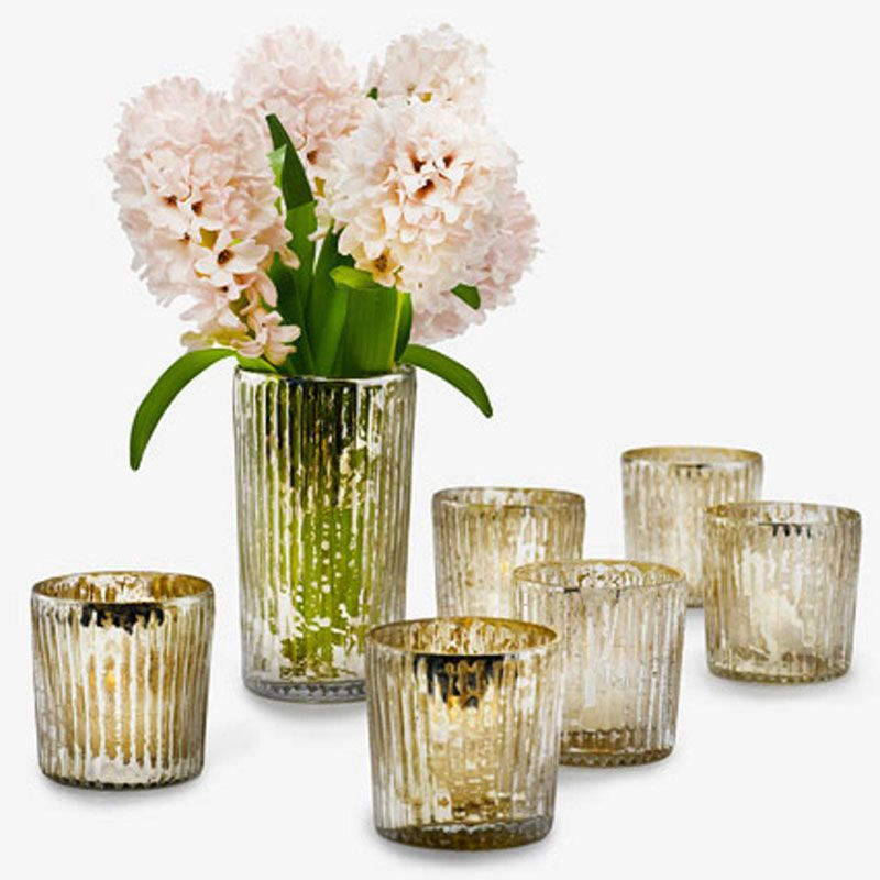 "<p>""I like to use votive candles when setting a table but also around the house in different places, such as mantels and side tables, to add a little sparkle.""</p><p><em>Jamali Garden votive holders, $16-$162, <a href=""http://www.jamaligarden.com/detail/21061/119/candles-and-lights/votive-%2B-tea-light-holders/antique-silver-ribbed-votive-holders.php"" target=""_blank"">jamaligarden.com</a>.</em> </p>"
