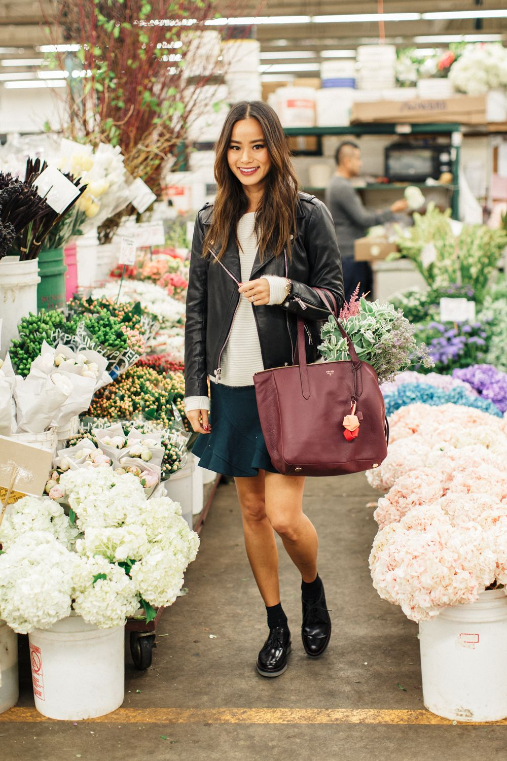 """<p>""""I love emerald and wine colors for the holidays&#x3B; white angora sweaters remind me of snowy winters. While I'm out running errands and buying small gifts, I like to use a large tote to carry my small purchases around. It beats lugging bags from different stores!""""</p>"""