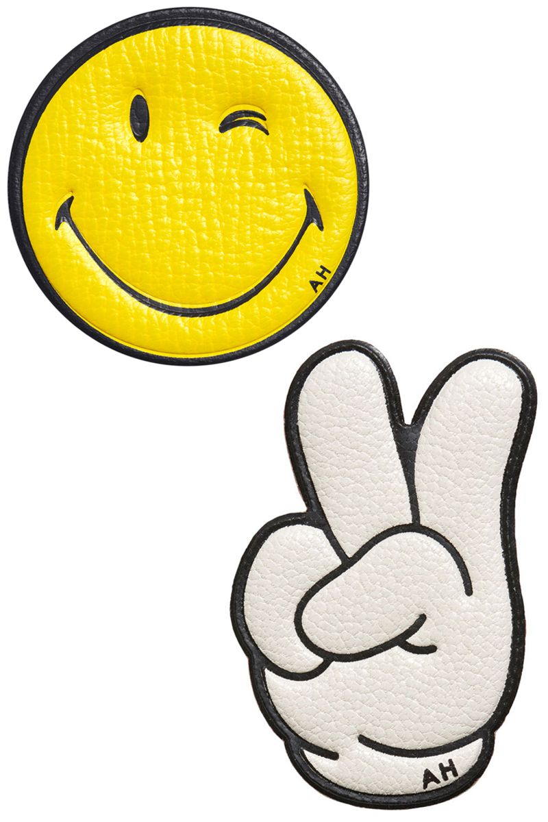 "<p><strong></strong><strong>Anya Hindmarch</strong> face sticker, $75, <a href=""https://shop.harpersbazaar.com/designers/a/anya-hindmarch/wink-face-6624.html"" target=""_blank""><strong>shopBAZAAR.com</strong></a>; <strong>Anya Hindmarch </strong>victory sticker, $75, <strong><a href=""https://shop.harpersbazaar.com/designers/a/anya-hindmarch/victory-peace-sticker-6621.html"" target=""_blank"">shopBAZAAR.com</a></strong>. </p>"