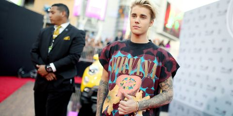 Suit, Street fashion, Tie, Blazer, Tattoo, Temporary tattoo, Bracelet, Toy, Active shirt, Stuffed toy,