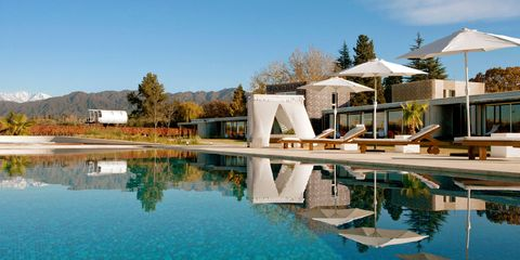 Water, Real estate, Resort, Swimming pool, Reflection, Outdoor furniture, Sunlounger, Resort town, Shade, Villa,