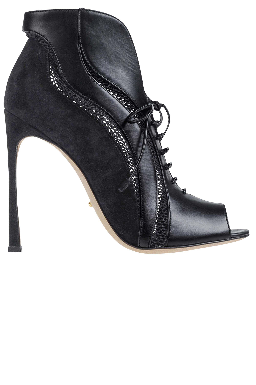 """<p><strong>Sergio Rossi </strong>booties, $1,050, <a href=""""https://shop.harpersbazaar.com/designers/s/sergio-rossi/heeled-booties-6999.html"""" target=""""_blank"""">shopBAZAAR.com</a>. </p>"""