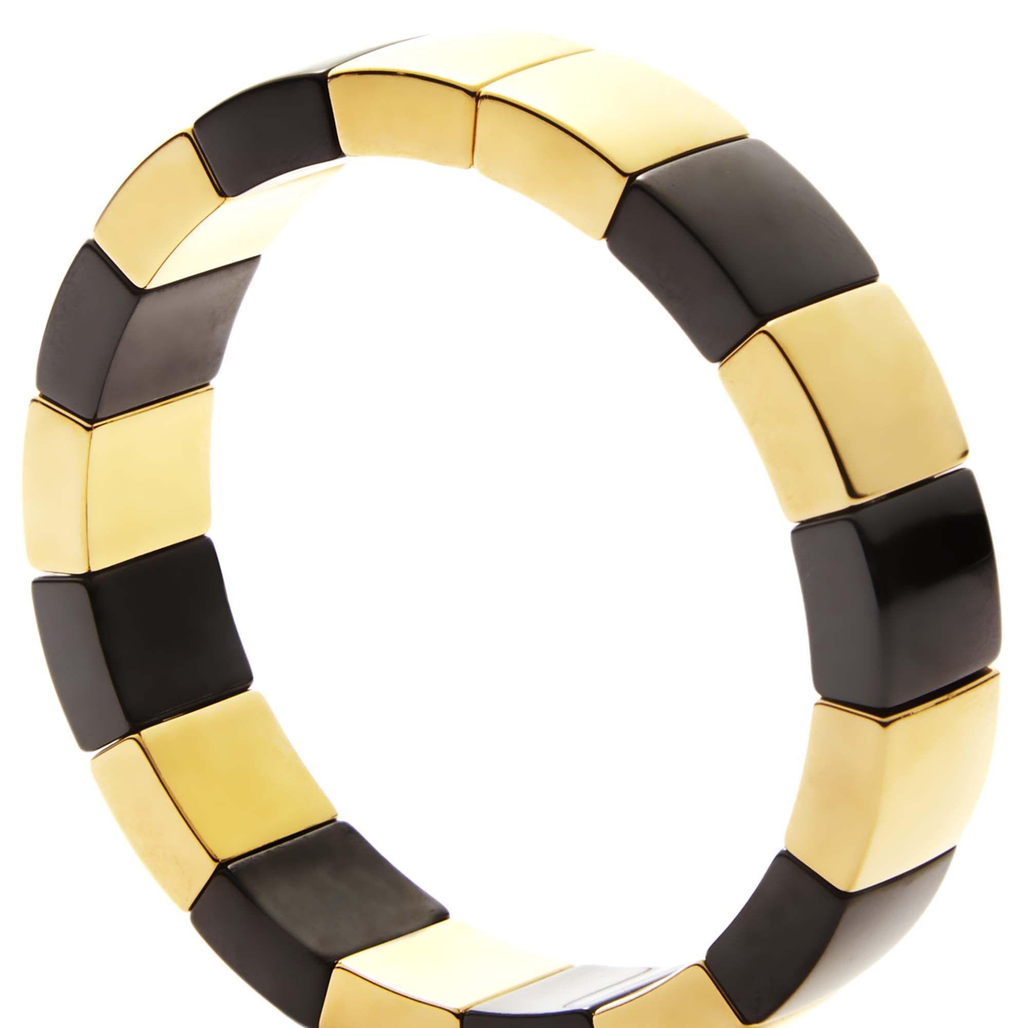 "<p><strong>Roberto Demeglio </strong>bracelet, $296, <a href=""http://www.robertodemegliousa.com/"" target=""_blank"">robertodemegliousa.com</a>. </p>"