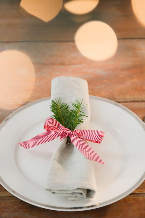 <p>Tie up each napkin with a fir branch and holiday ribbon.</p>