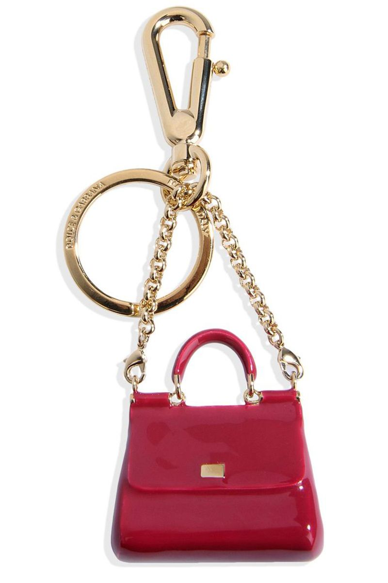 """<p>Downsize your Dolce…</p><p><br></p><p><strong>Dolce & Gabbana</strong> keychain, $425, <strong><a href=""""https://shop.harpersbazaar.com/designers/d/dolce-and-gabbana/key-ring-6737.html"""" target=""""_blank"""">shopBAZAAR.com</a></strong>.<br></p>"""