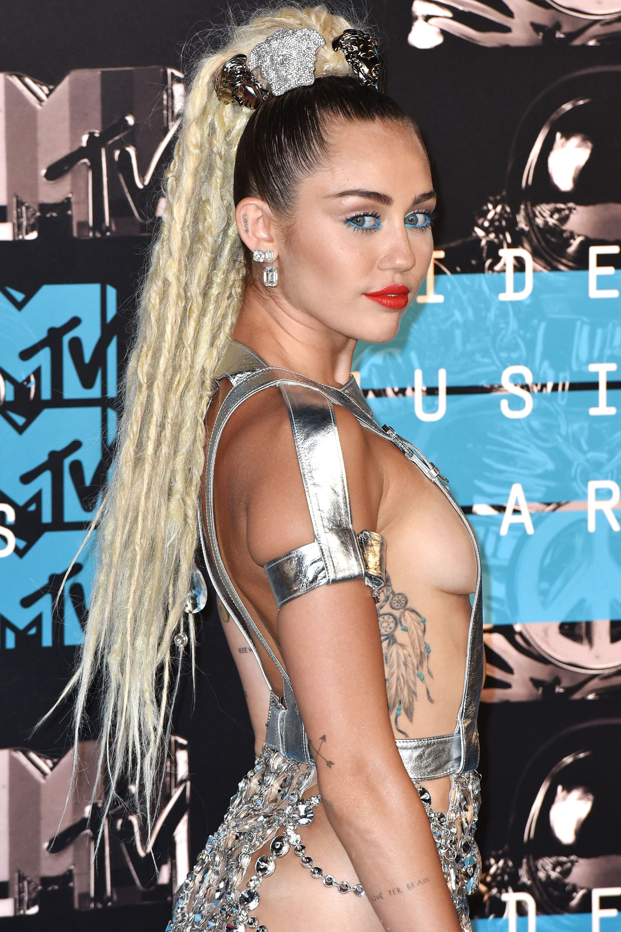 <p>Cyrus took her gig as host of the year's wildest awards show seriously, showing up nearly naked and with a heavy head of dreads that put her under fire. </p>