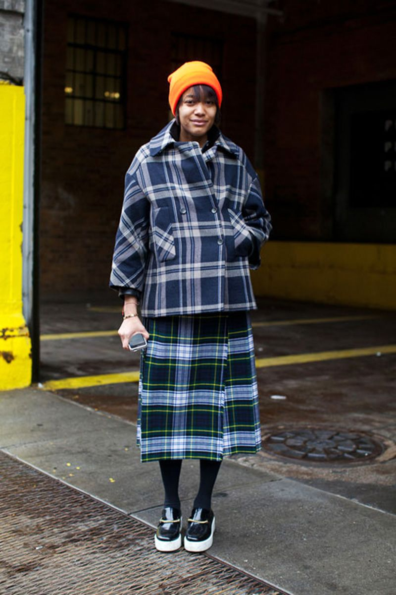 <p>Who says you can't mix a pop of color with a little pattern play? Keep your plaids within the same color palette for a seamless look, topping it off with a punchy beanie of your choice. </p>