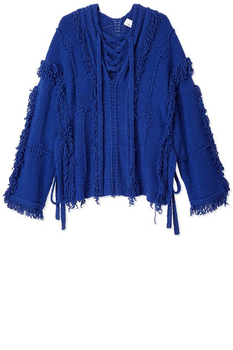 "<p><strong>3.1 Phillip Lim</strong> poncho, $775, <strong><a href=""https://shop.harpersbazaar.com/designers/0-9/31-phillip-lim/fringe-stitch-poncho-7982.html"" target=""_blank"">shopBAZAAR.com</a></strong>. </p>"
