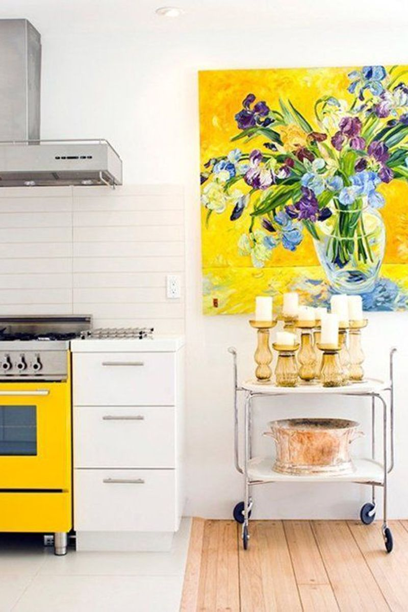 "<p>Liven up white kitchen walls with a bright pop-color painting and movable cart, complete with gold candle holders for a dose of metal. </p><p><a href=""http://www.apartmenttherapy.com/5-small-design-details-to-add-today-for-a-cheerier-kitchen-217993?crlt.pid=camp.oAZTGdhBszgj""></a><em><a href=""http://www.apartmenttherapy.com/5-small-design-details-to-add-today-for-a-cheerier-kitchen-217993?crlt.pid=camp.oAZTGdhBszgj"" target=""_blank"">Via Apartment Therapy</a>. </em></p>"
