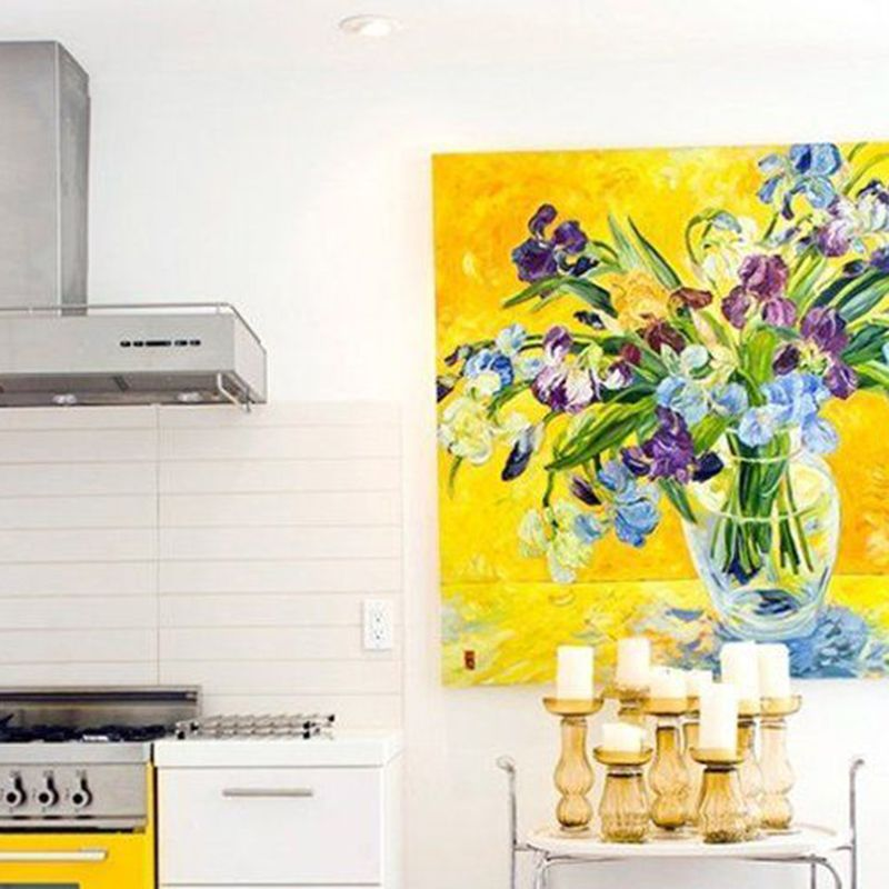 """<p>Liven up white kitchen walls with a bright pop-color painting and movable cart, complete with gold candle holders for a dose of metal. </p><p><a href=""""http://www.apartmenttherapy.com/5-small-design-details-to-add-today-for-a-cheerier-kitchen-217993?crlt.pid=camp.oAZTGdhBszgj""""></a><em><a href=""""http://www.apartmenttherapy.com/5-small-design-details-to-add-today-for-a-cheerier-kitchen-217993?crlt.pid=camp.oAZTGdhBszgj"""" target=""""_blank"""">Via Apartment Therapy</a>. </em></p>"""