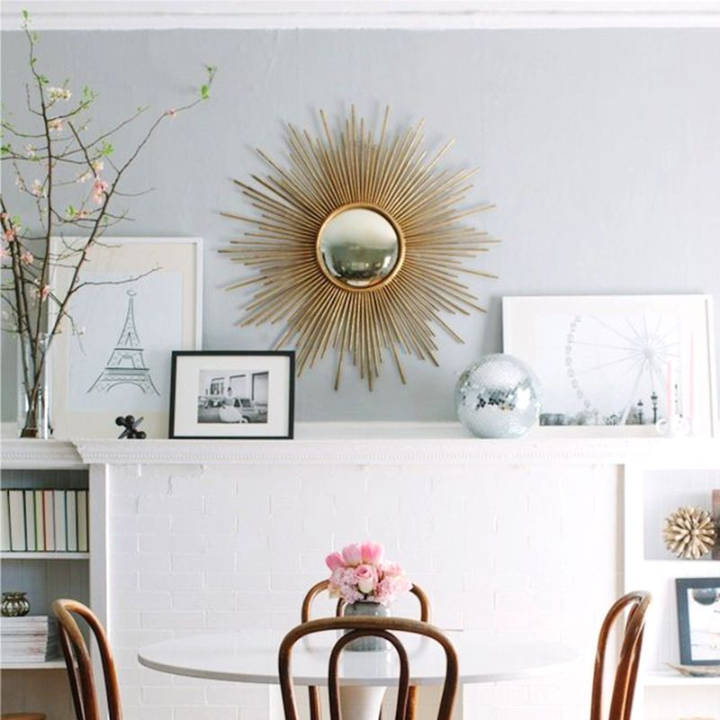 """<p>Choose one eye catching piece, like a statement mirror, that livens up any space and can easily be decorated around. </p><p><em><a href=""""http://www.decor-eat.com/2013/04/the-everygirl-co-founder.html"""" target=""""_blank"""">Via Decor-Eat.com</a>. </em></p>"""