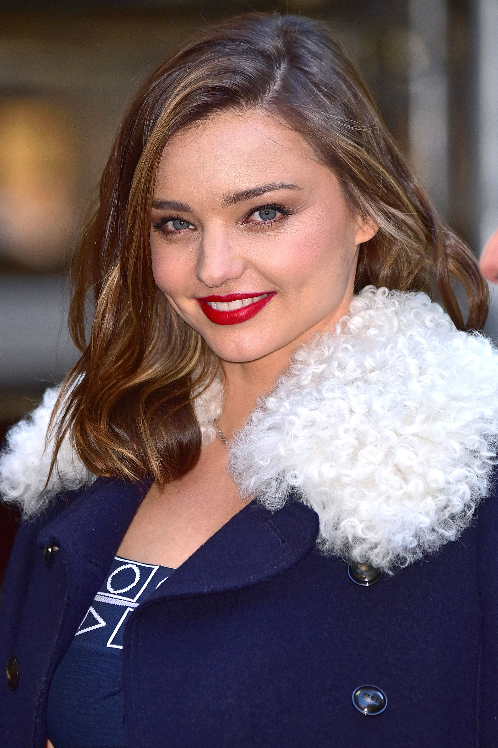 <p>Red lipstick and a statement coat say seasoned pro.</p>