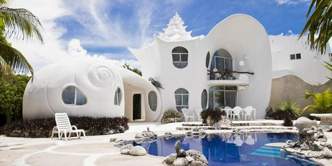 Architecture, Real estate, Water feature, Swimming pool, Design, Paint, Arch, Outdoor furniture, Villa, Yard,