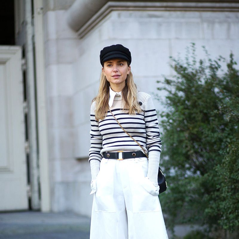 <p>Black and white Breton stripes may seem just as stereotypically French as berets (ever been a mime for Halloween?) but modern iterations keep the trend fresh, especially when it's paired with unexpected pieces like wide-leg pants.</p>