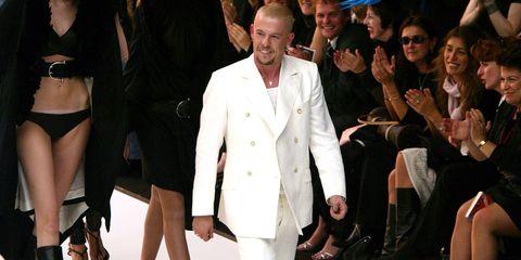 Dress shirt, Coat, Outerwear, Hat, Suit, Collar, Formal wear, Blazer, Fashion, Suit trousers,