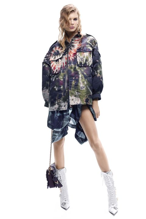 """<p><em><a href=""""http://www.valentino.com/us"""" target=""""_blank"""">Valentino</a> jacket, $7,200, and shirt (worn as a skirt), $2,200, 212-355-5811; <a href=""""http://www.waltcassidy.com/"""" target=""""_blank"""">Walt Cassidy Studio for Derek Lam</a> </em><span class=""""redactor-invisible-space""""><em>earrings, $495, 212-493-4454; <a href=""""http://www.valentino.com/us"""" target=""""_blank"""">Valentino Garavani</a> </em><span class=""""redactor-invisible-space""""><em>bag, $4,445, 212-355-5811; <a href=""""http://www.marcjacobs.com/"""" target=""""_blank"""">Marc Jacobs</a> </em><span class=""""redactor-invisible-space""""><em>boots, $4,195, <a href=""""http://marcjacobs.com"""" target=""""_blank"""">marcjacobs.com</a>.</em> </span></span></span></p>"""