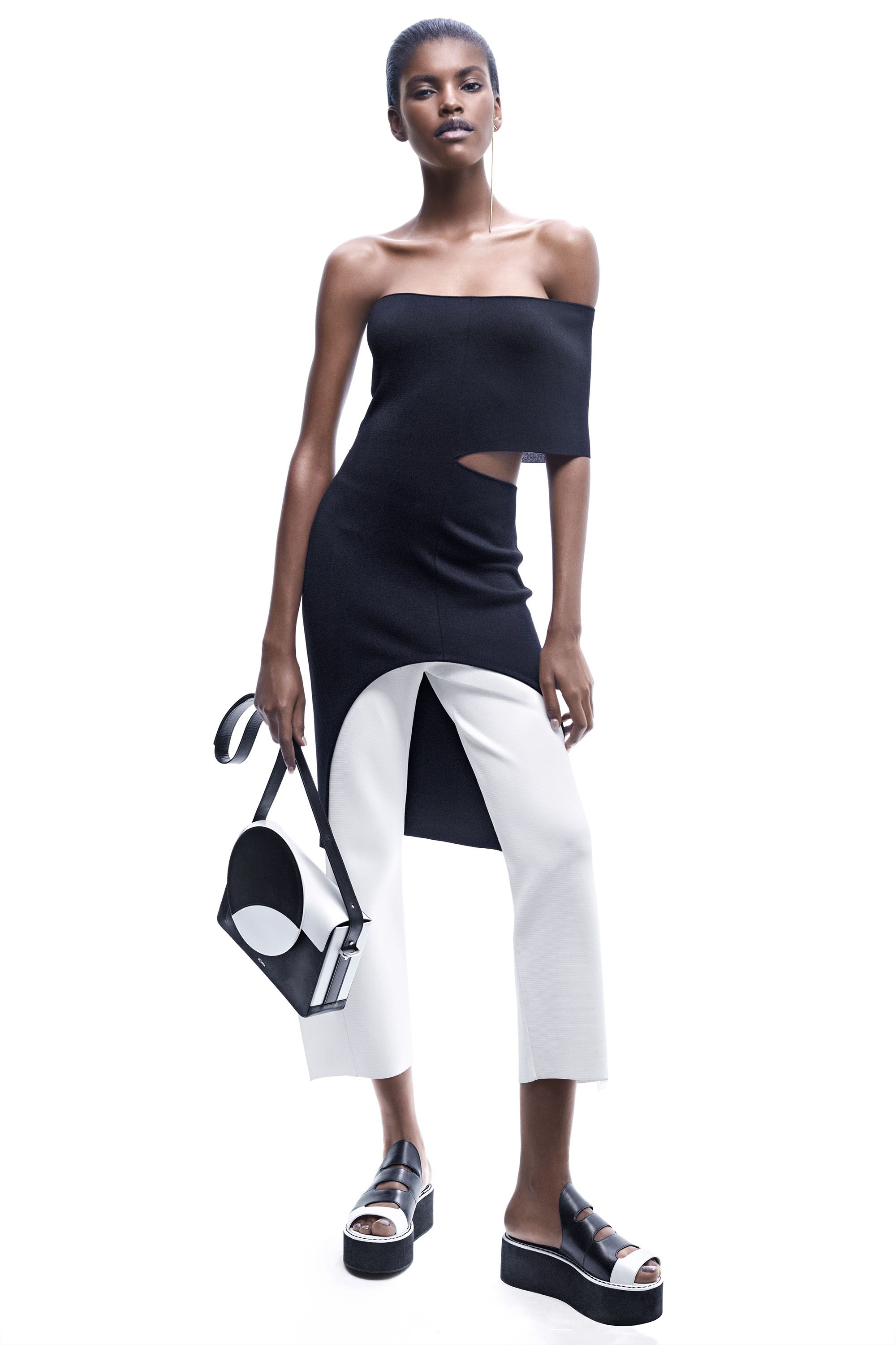 "<p><em><a href=""http://www.stellamccartney.com/us"" target=""_blank"">Stella McCartney</a> dress, $1,340, and pants, $1,270, 212-255-1556; <a href=""http://www.tuleste.com/"" target=""_blank"">Tuleste</a> </em><span class=""redactor-invisible-space""><em>earrings, $195, <a href=""http://nordstrom.com"" target=""_blank"">nordstrom.com</a>; <a href=""http://perrinparis.com/en/"" target=""_blank"">Perrin Paris</a> </em><span class=""redactor-invisible-space""><em>bag, $1,950, <a href=""http://perrinparis.com"" target=""_blank"">perrinparis.com</a>; <a href=""http://www.fendi.com/us/"" target=""_blank"">Fendi</a> </em><span class=""redactor-invisible-space""><em>sandals, $795, 212-897-2244.</em></span></span></span></p>"