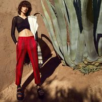 """<p><strong><a href=""""http://www.missoni.com/"""" target=""""_blank"""">Missoni</a></strong> top, $965, and pants, $1,635, 212-517-9339&#x3B; <strong><a href=""""http://aureliebidermann.com/edito/en/?gclid=CjwKEAiAuKy1BRCY5bTuvPeopXcSJAAq4OVsB4O9qvCYDAO9Km9fiwOX7J6WtM5Tl4KOs1UGEECQThoCdnnw_wcB"""" target=""""_blank"""">Aurélie Bidermann</a></strong> earrings, $405, 212-335-0604&#x3B; <strong>Denis Colomb </strong>shawl, $995, <a href=""""http://santafedrygoods.com/pcat/39/?designer_id=20"""" target=""""_blank"""">santafedrygoods.com</a>&#x3B; <strong><a href=""""http://us.louisvuitton.com/eng-us/homepage?campaign=sem_GG-US-ENG-EC-BRAN-BREX"""" target=""""_blank"""">Louis Vuitton</a></strong> sandals, price upon request, 866-VUITTON.</p>"""