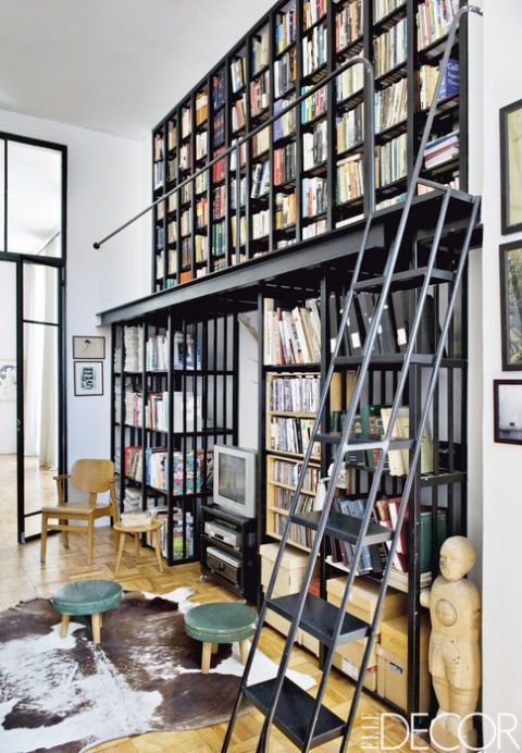 <p>Laureen Rossouw, editor of <em>ELLE Decoration South Africa</em>, devised a double-height metal shelving unit for the study of her Cape Town apartment. The 1950s stools and chair were purchased at local antiques shops.</p>