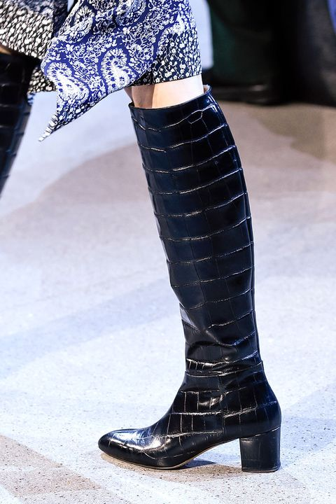 Blue, Textile, Human leg, Fashion, Electric blue, Boot, Street fashion, Umbrella, Knee-high boot, Leather,