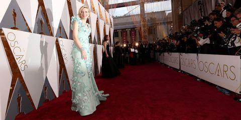 Flooring, Floor, Carpet, Dress, Formal wear, Gown, Hall, Red carpet, Premiere, One-piece garment,