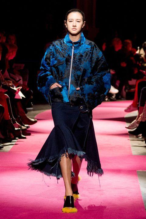 Fashion show, Human body, Runway, Outerwear, Red, Style, Jacket, Fashion model, Fashion, Carpet,