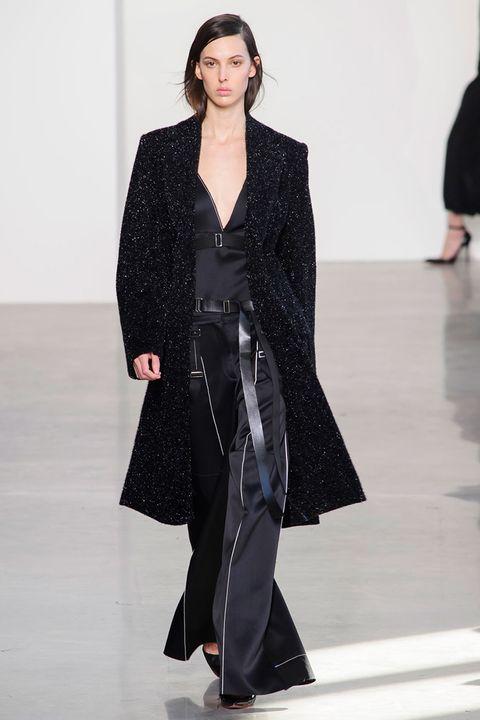 Sleeve, Shoulder, Fashion show, Joint, Outerwear, Fashion model, Coat, Style, Runway, Formal wear,